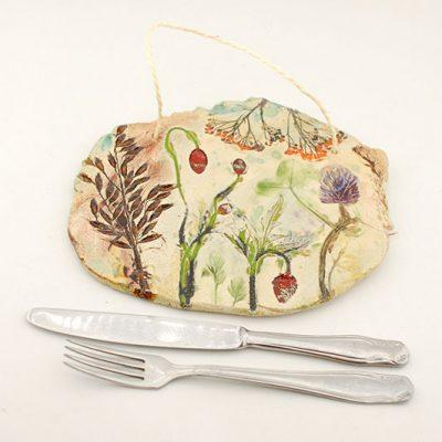 ceramiczna podstawka z motywem łąki